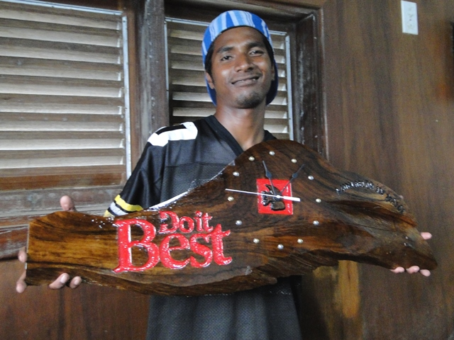 Former WAM trainee Rinky Hersey with a clock he produced for Majuro hardware store Do It Best.