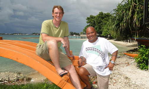 Researcher of Marshallese navigation Joe Genz with WAM Director Alson Kelen at the Canoe House alongside Majuro lagoon. Photo credit Karen Earnshaw