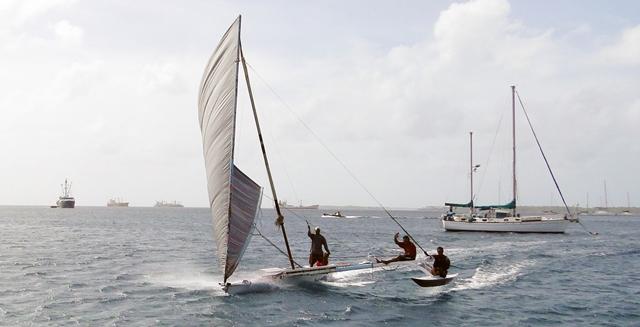 A trio of guys zip along Majuro lagoon.