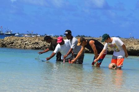 Davidson David, Binton Daniel, Linton Baso, Grant Bilyard and his son Tayne in the grand final of the Mieco Beach Yacht Club Recycle Can Race. Photo: Karen Earnshaw