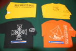 WAM has T-Shirts in three styles. Vertical logo with canoe logo on back (yellow). Stick chart on back (black). Canoe on back (orange).