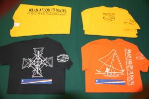 WAM has T-Shirts in three styles. Vertical logo with canoe logo on back (yellow). Stick chart on back (black). Canoe on back (orange).