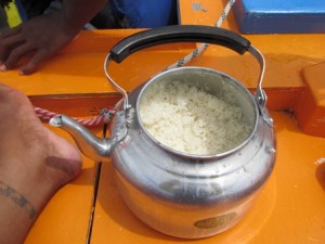 A precious teapot of rice cooked on a burner set under the deck. Photo: WAM