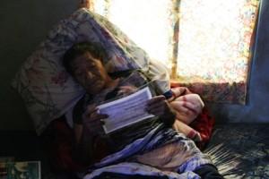 Captain Korent Joel studies paperwork brought by the scientists. Photo: WAM