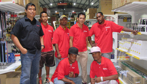 WAM 2015 alumni Michealson Jihu and Jammy Edward, at front, with there colleagues at the True Value Store in Delap. Photo: Tolina Tomeing
