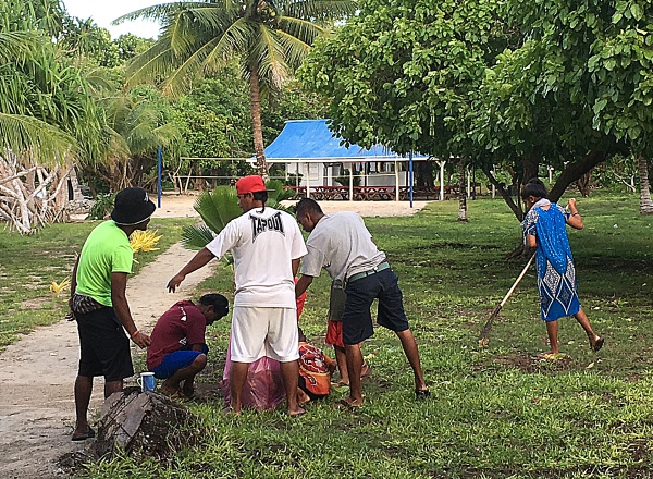 Group cleanup each day. Photo: Alson Kelen