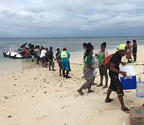 WAM trainees and staff bringing provisions ashore. Photo: Alson Kelen