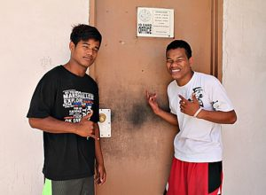 WAM trainees Dalas Henry and Jerry Anjain applying for identification cards. Photo: Sealend Laiden