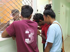 WAM trainees Johnson Anwel, Carlon Jetton and Jerryann Harkey applying for birth certificates. Photo: Suemina Bohanny