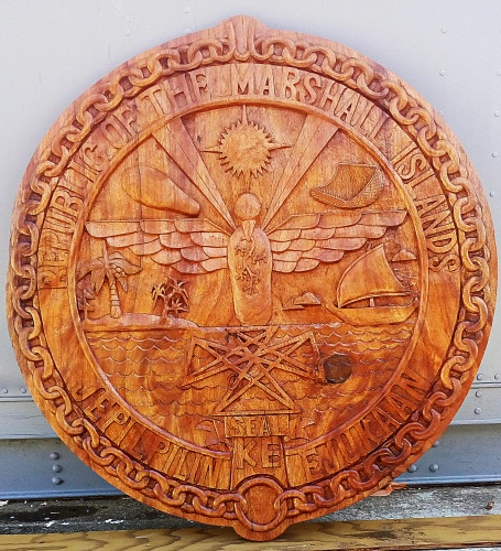GEF Trainees create a beautiful carved Government Seal from Lukwej. Photo: Suemina Bohanny
