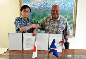 Japan Ambassador Hideyuki Mitsuoka and Director of WAM Alson Kelen with signed agreement. Photo: Embassy staff member