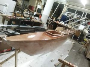 Epoxy being applied to the canoe. Photo: Esther Kokmeijer